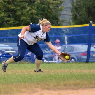 Kady Olsen Stops a Ball in Right Field