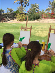 girls painting on canvas