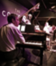 Mike Denham plays piano with the Sunset Cafe Stompers