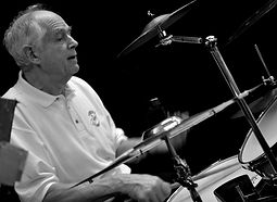 John Coad plays drums with the Sunset Cafe Stompers