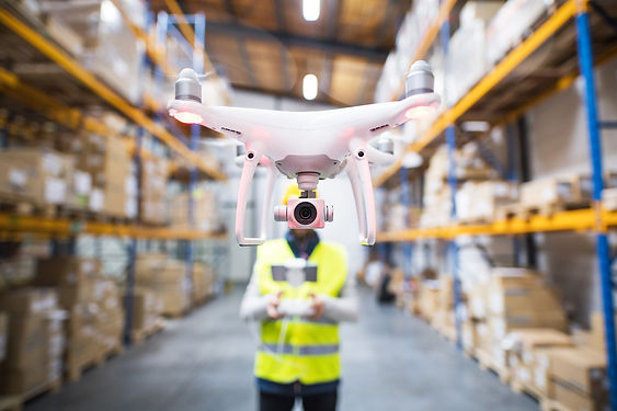 man-with-drone-in-a-warehouse-PYKPMM2.jp