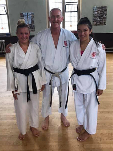 Claire and Tonika BlackBelts.jpg