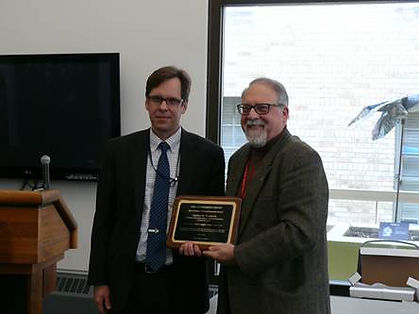 Andrew Novakovic is presented the Bruce Gardner Award by USDA Acting Chief Economist Robert Johannson