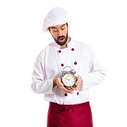 surprised-chef-holding-a-clock-over-white-background.jpg