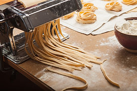 the-fresh-pasta-and-machine-on-kitchen-table.jpg