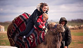 Mom & Kid On A Camel Ride