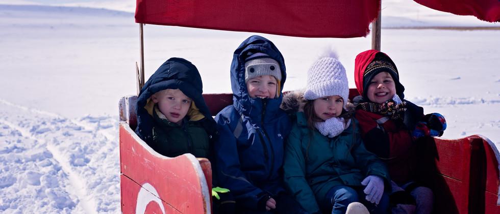 Kids On A Horse Drawn Sleigh Ride Over Lake Cildir