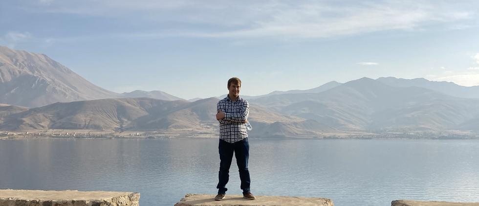 Man In Front Of Van Lake