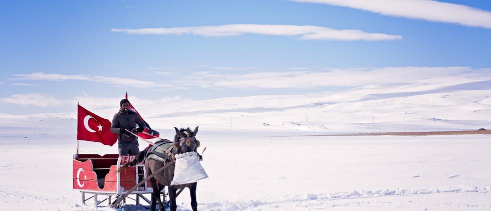 Horse Drawn Sleigh Over Lake Cildir
