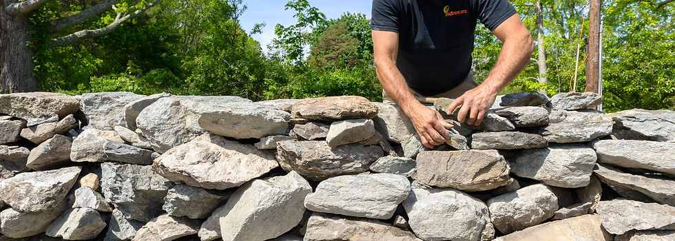 Indresano Corporation landscaping design, construction and maintenance – Hand built stone wall made by team