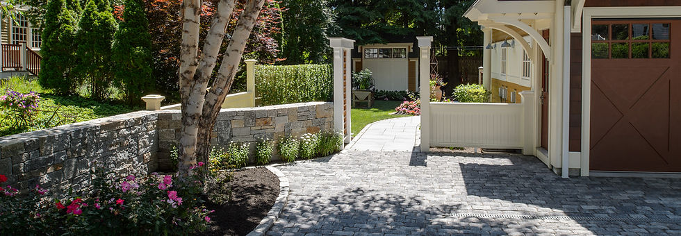 Indresano Corporation landscaping design, construction and maintenance – Masterfully crafted stone wall, cobblestone driveway