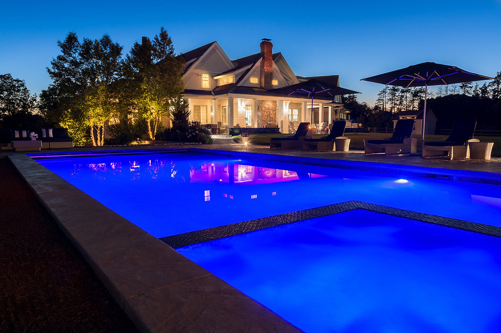 Indresano Corporation landscaping design, construction and maintenance – Evening swimming views with great lighting