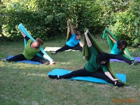 Women exercising in the yard on a beautiful summer day