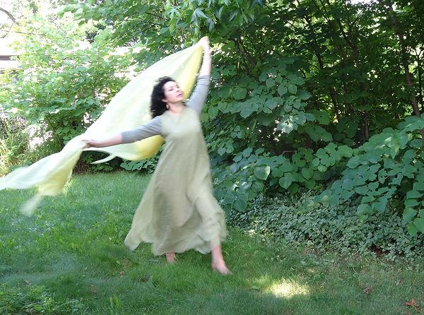 Carolynn Hine-Johnson dancing in the garden