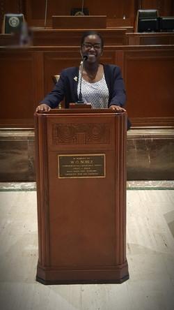 Ms. Clark at the Podium