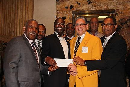 LLBC Members presenting check to Grambling State University President Rick Gallot