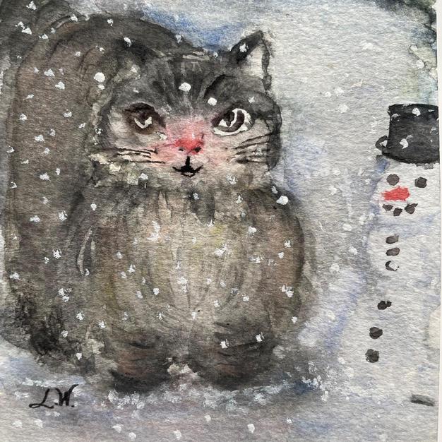 Katt med lilla snögubbe