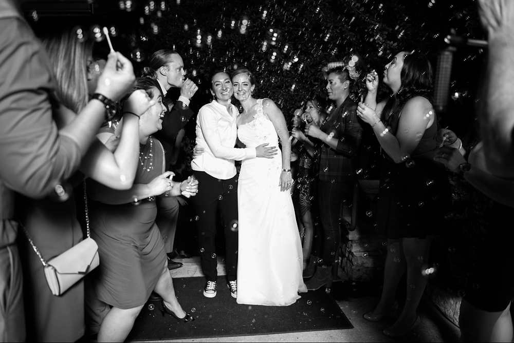 bride and bride with bubbles by lively events
