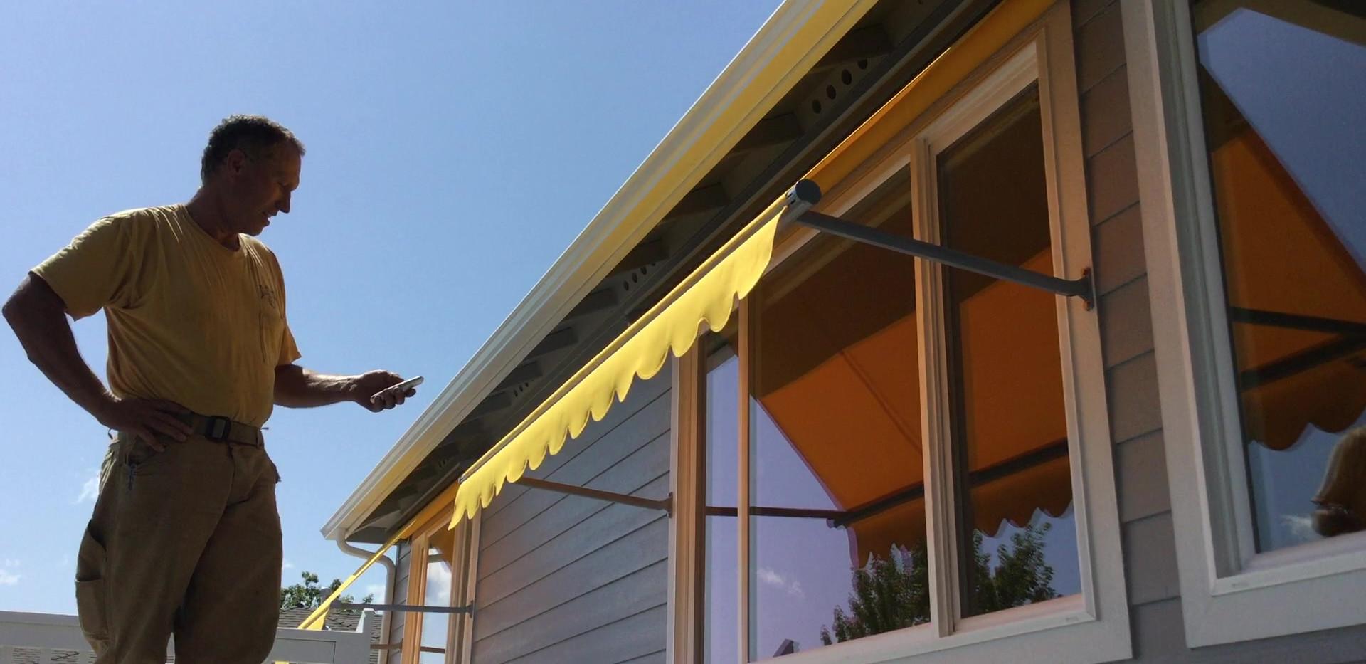 Mototized window awnings