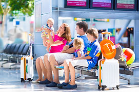 Family with baby at airport