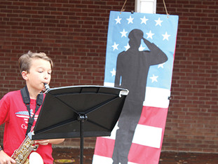 School honors veterans with car parade