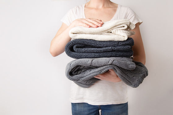 girl-is-holding-a-pile-of-washed-and-iro