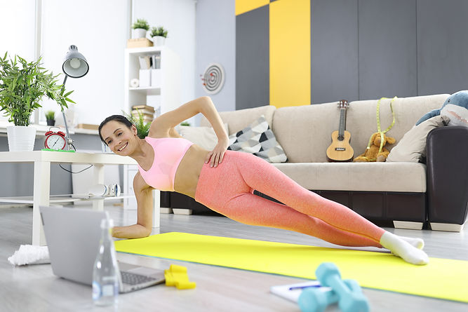 woman-makes-side-plank-and-looks-into-la