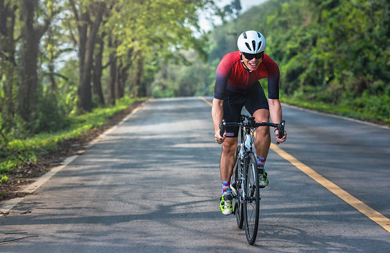 asian-men-are-cycling-road-bike-in-the-m
