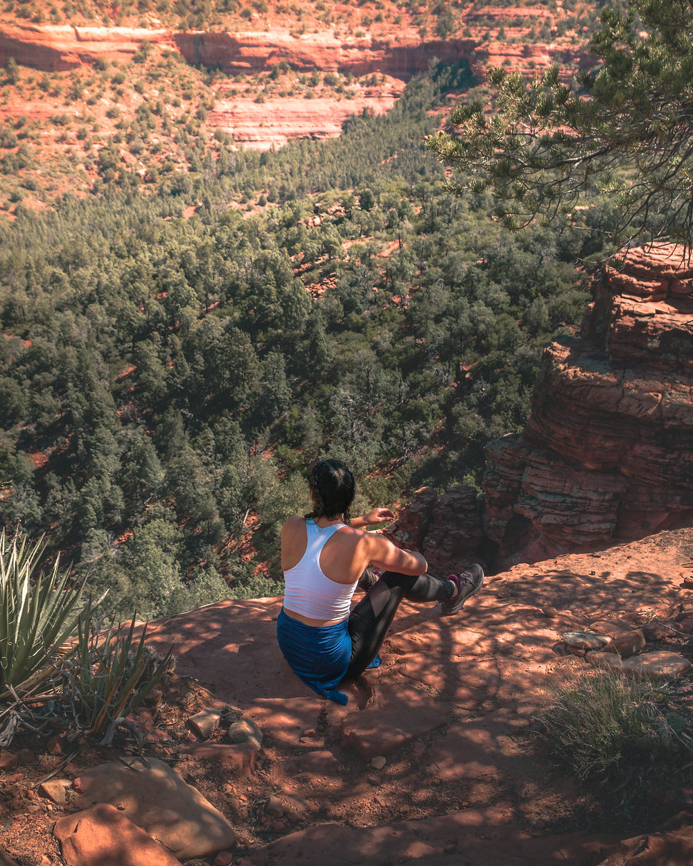 Hiker sitting on the ledge of a trail in sedona