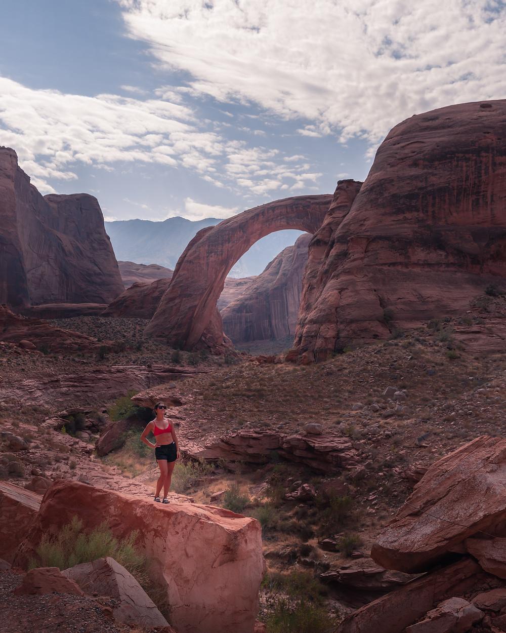 Girl hiking and posing at Rainbow Bridge National Monument