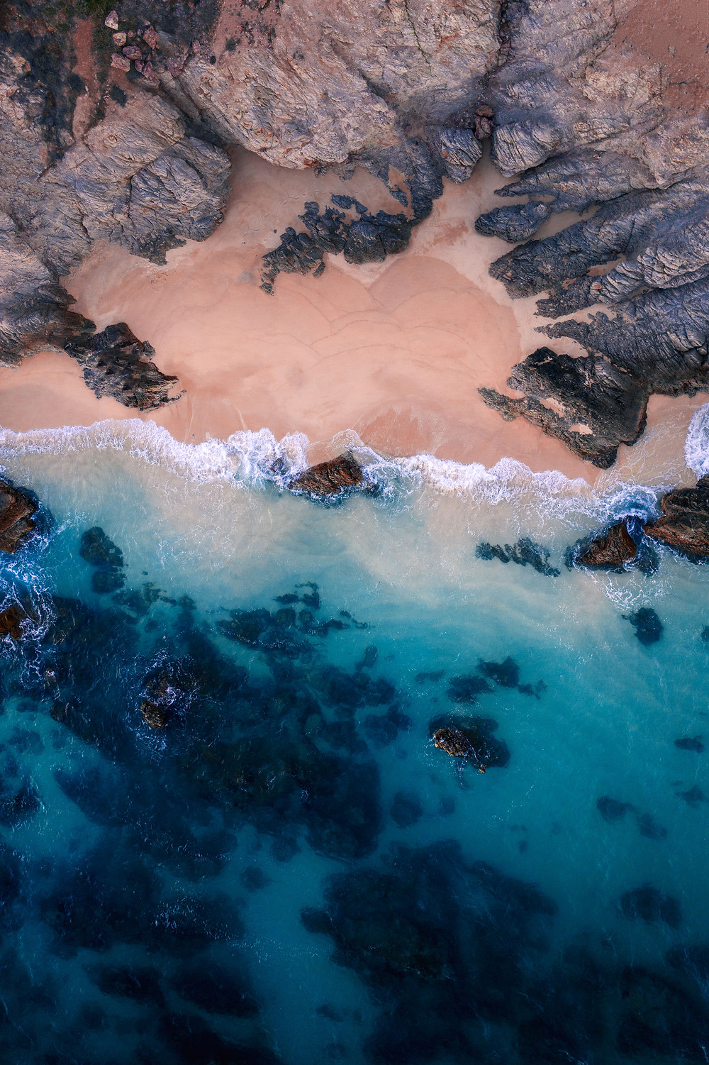 Aerial view of a private beach with clear blue waters