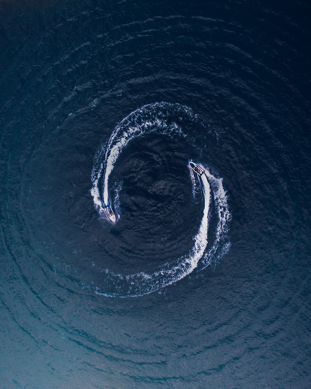 Aerial view of two jet skis riding in a circle