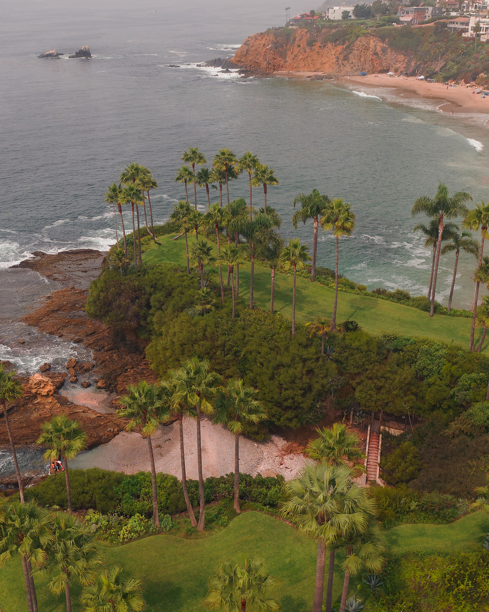 Shaws Cove between beautiful lush green cliffs and palm trees