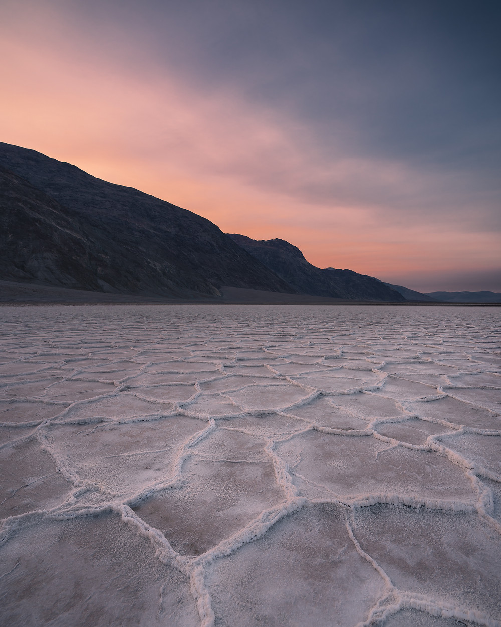 colorful sunset sky over the white salt flats in Death Valley