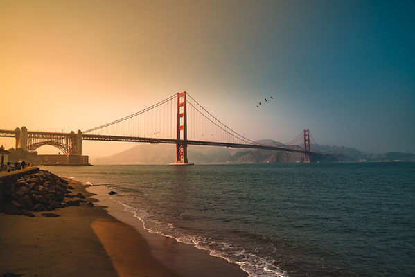 The iconic Golden Gate Bridge from Crissy Field Park at Sunet