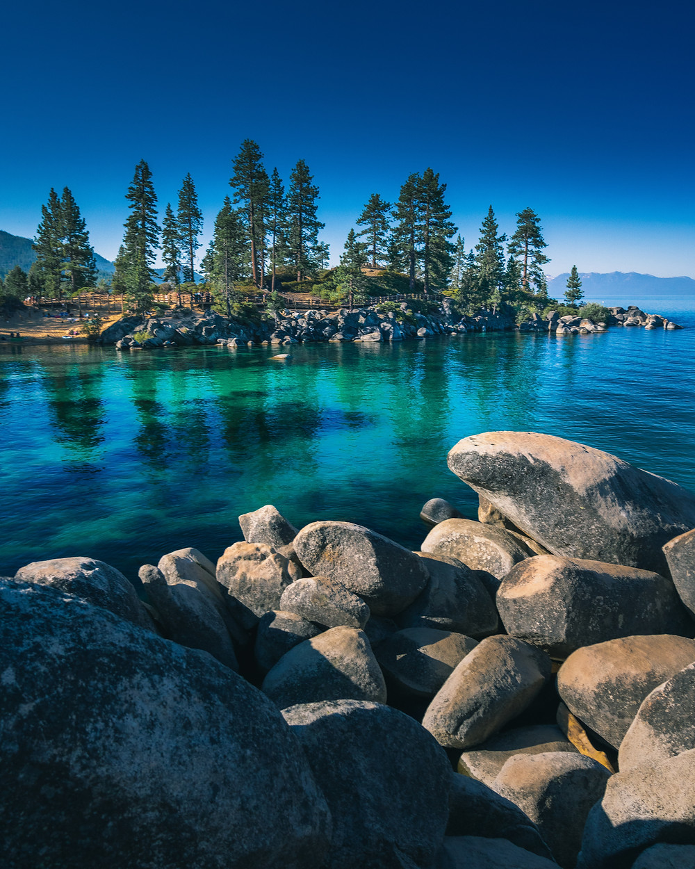 Crystal clear and calm glassy waters of Sand Harbor Beach in Lake Tahoe