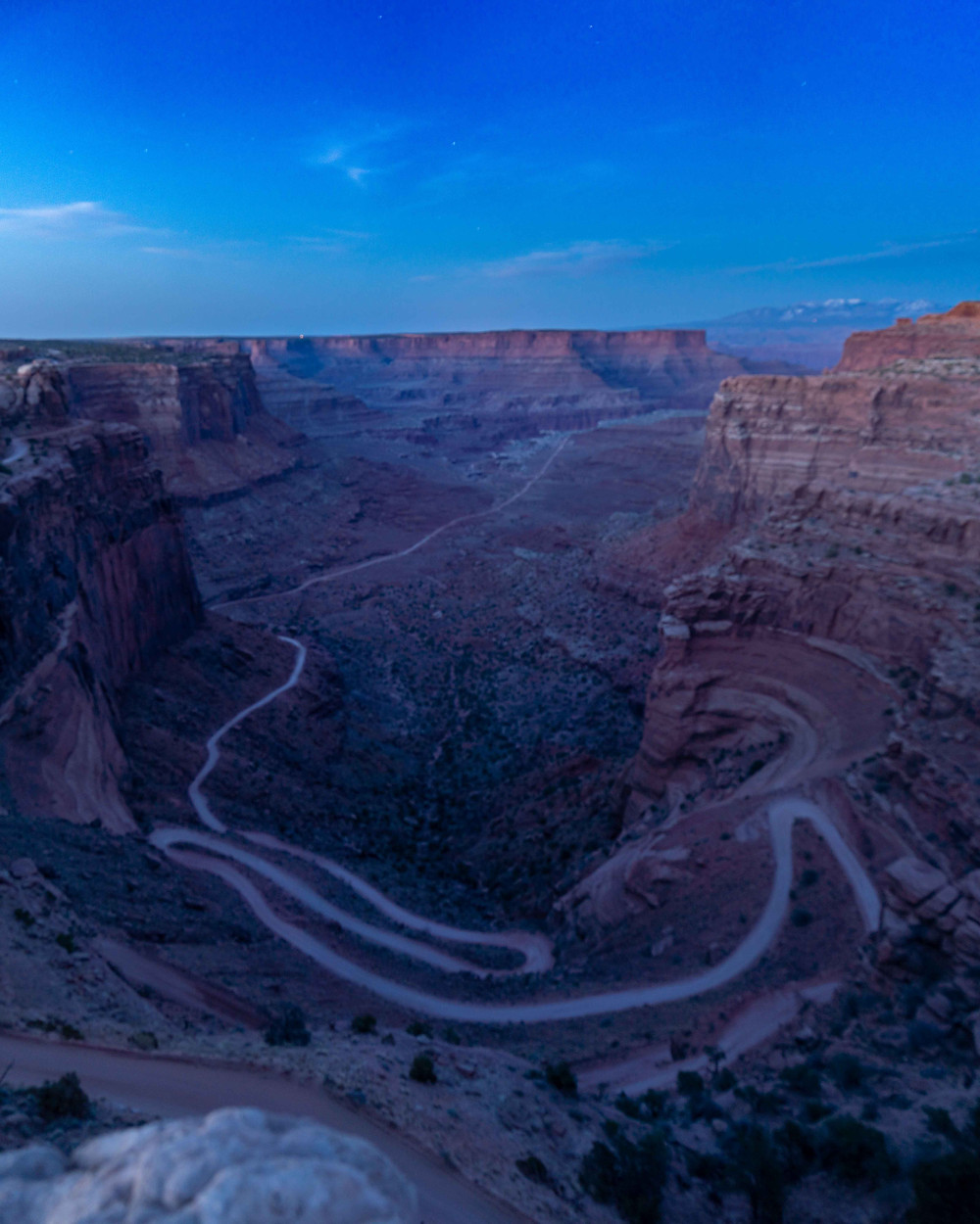 twlight blue hour photo of the shafer trail and canyon floor