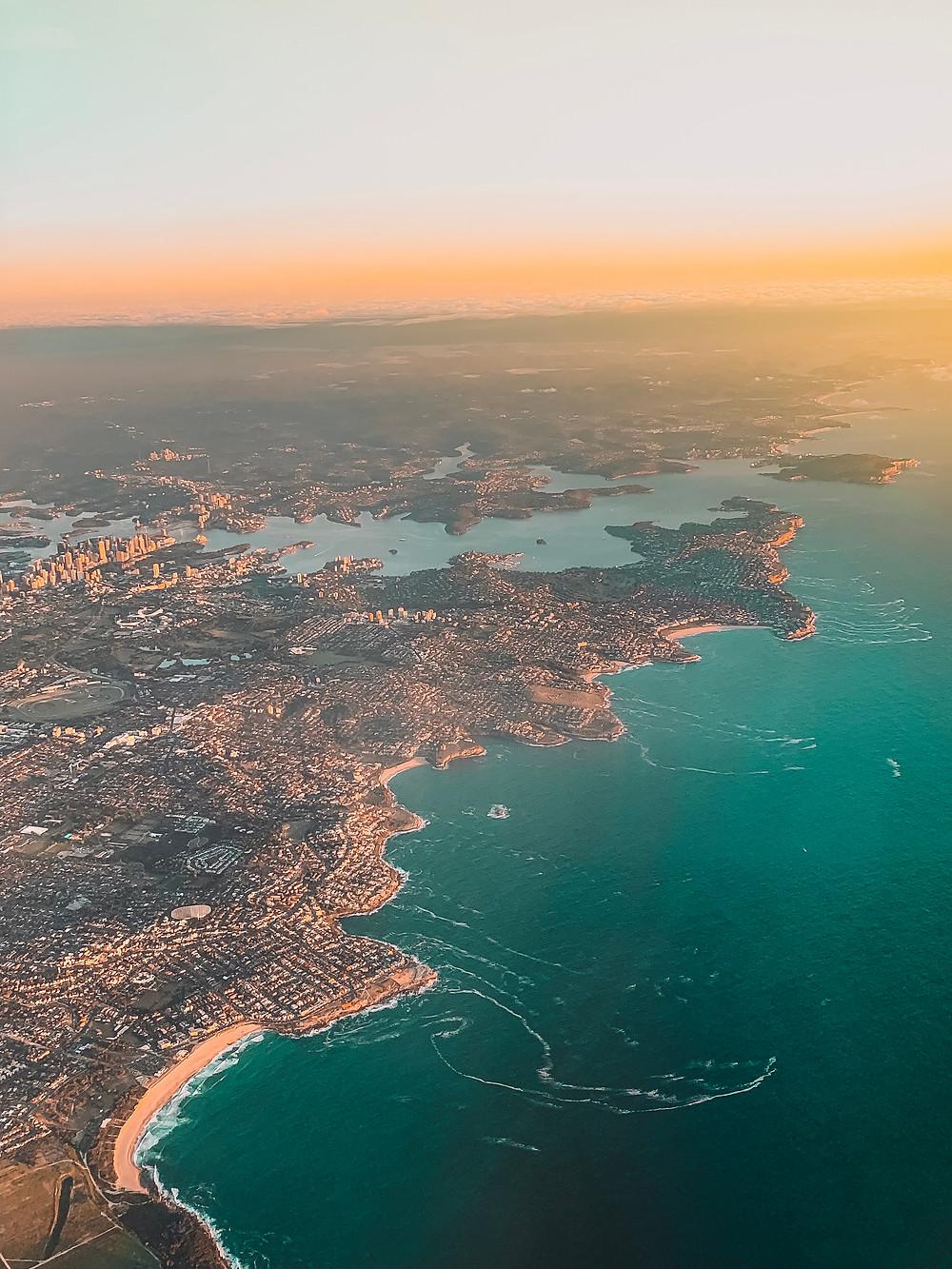 Aerial view of Sydney Harbor and Coastline at Sunrise