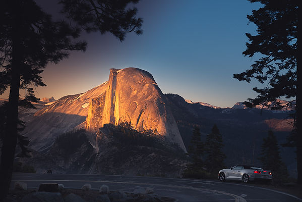Car pulled ove to enjoy the Half Dome Sunset in Yosemite National Park