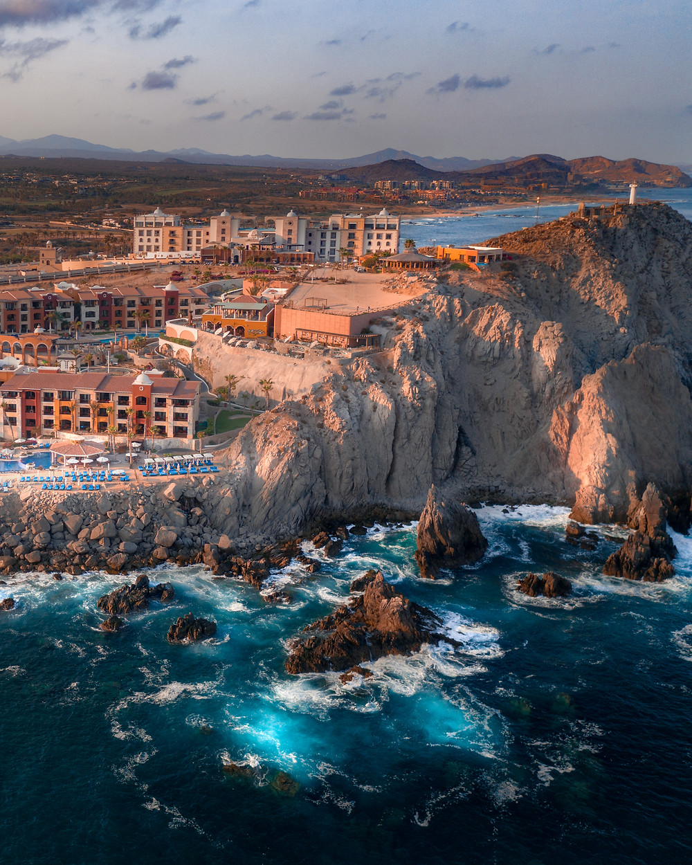 View of a hotel sitting along the cliffs above the ocean