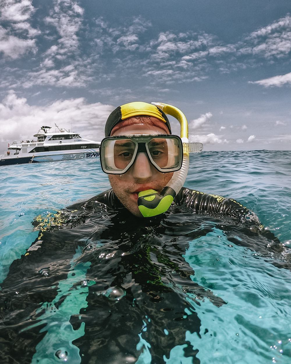 Man snorkeling the great barrier reef with a rash guard protection