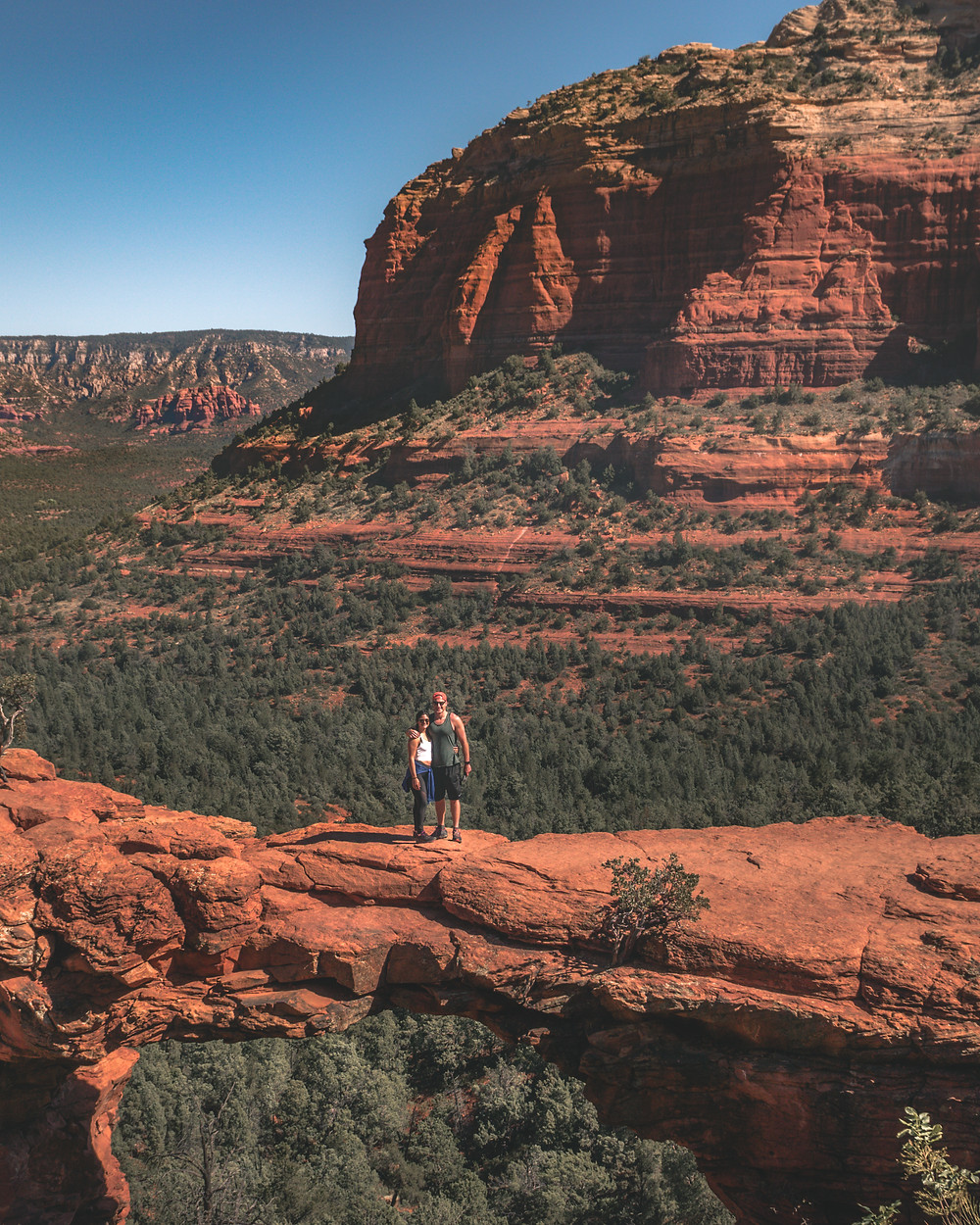 Two hikers standing at the top of devils bridge