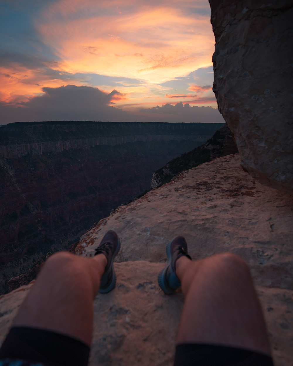 point of view watching sunset from the grand canyon overlook