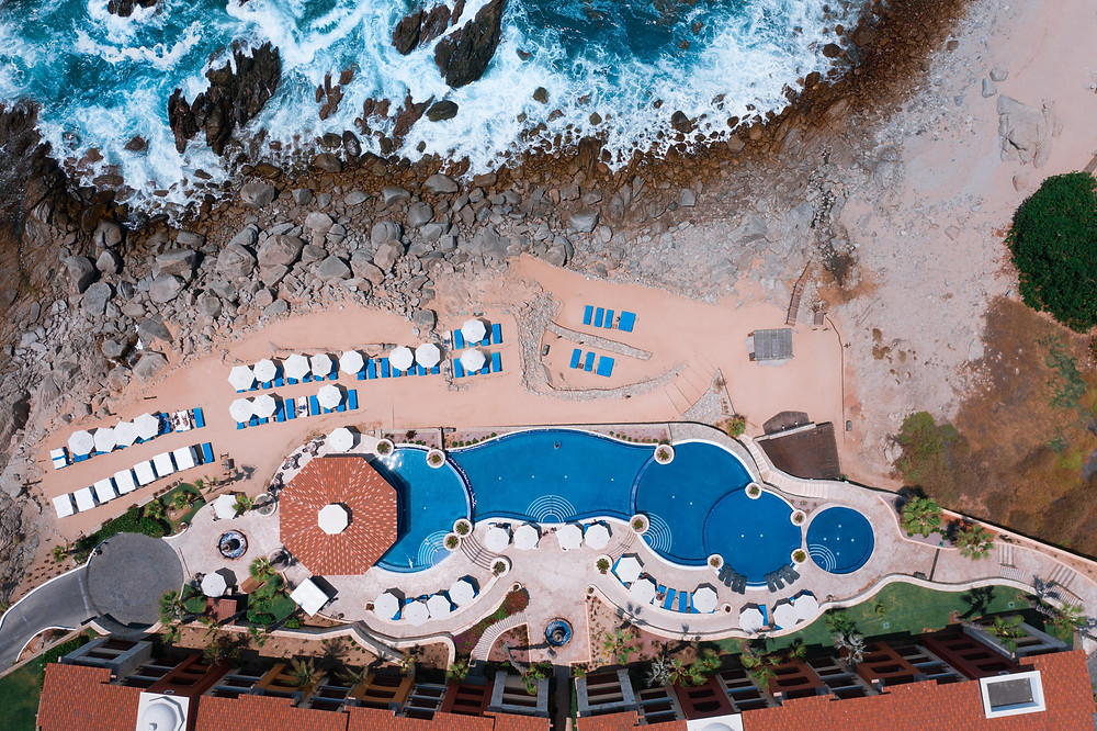 Aerial View of an infinity pool along the beach