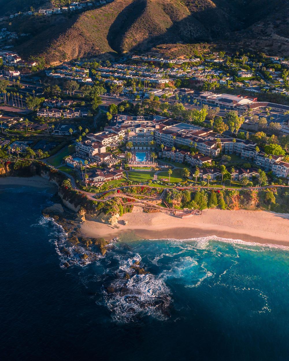 Montage Laguna Beach resort sitting over a beautiful cliff overlooking blue ocean waters