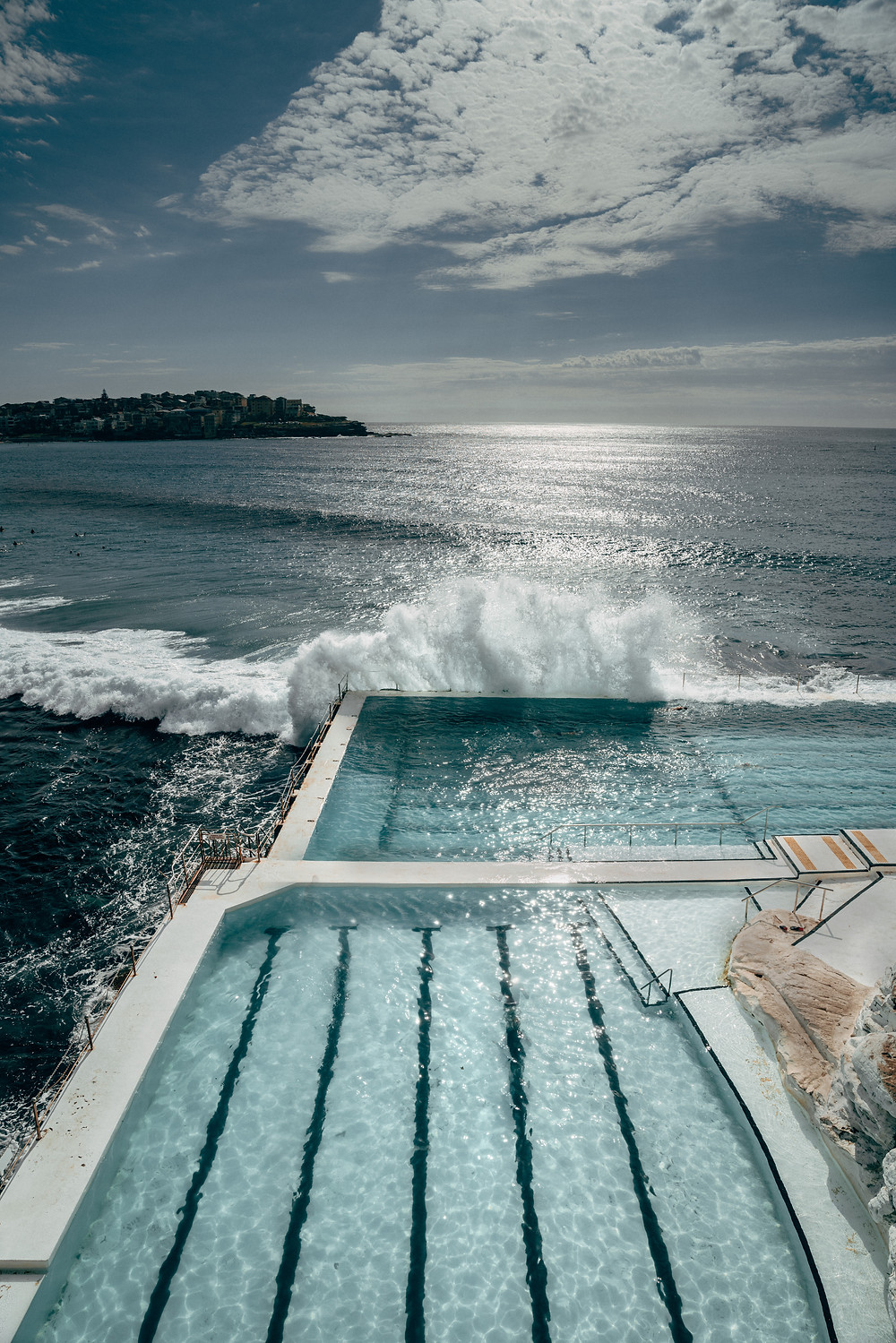 The crashing ocean waves coming on to the Bondi Icebergs olympic swimming pool