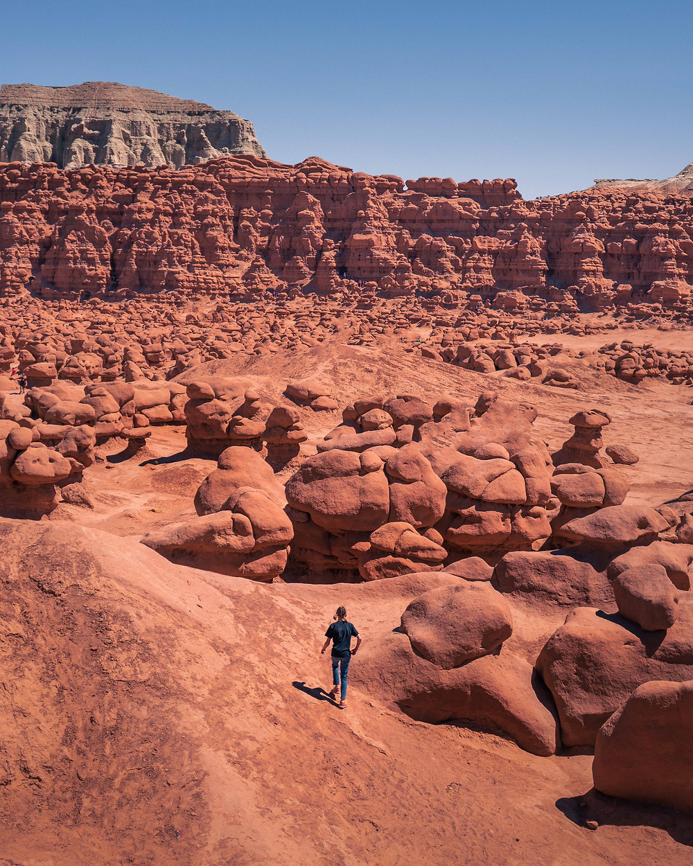 Hiker standing in the middle of the Goblin Valley State Park
