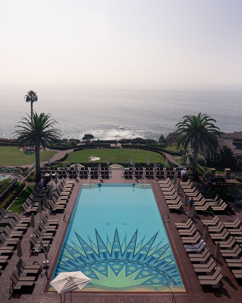 The iconic sun themes mosaic tile pool overlooking the Pacific Ocean at the montage laguna resort