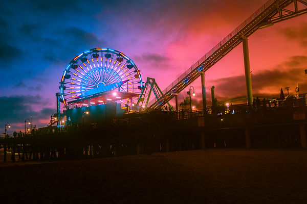 Santa Monca Ferris Wheel at the Pier on a moody sunset evening