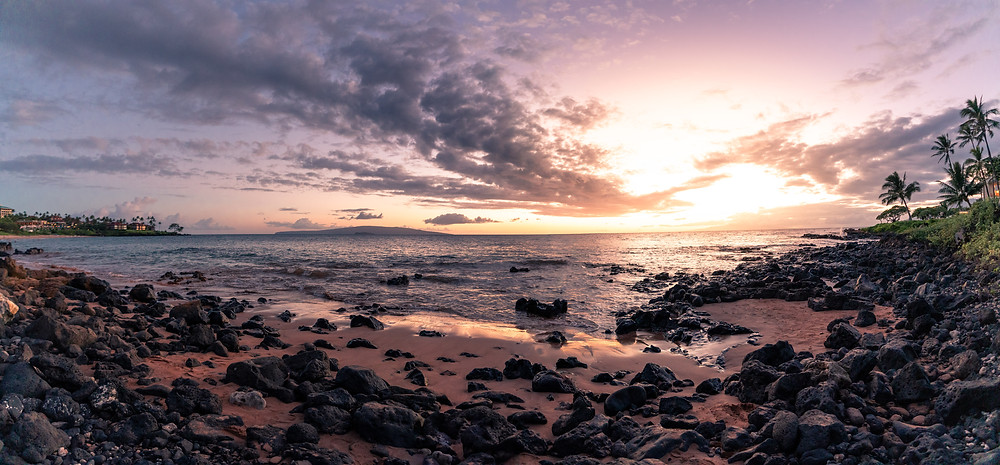 panorama view of a sunset on a rocky beach in Hawaii